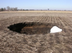 Sinkhole A tractor-sized sinkhole near Eagle, Wisconsin, that appeared the day after the field was harvested.