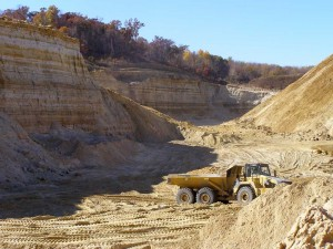 Active pit of a frac sand mine with a truck for scale