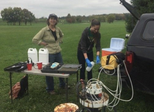 WGNHS staff collecting water for radium testing