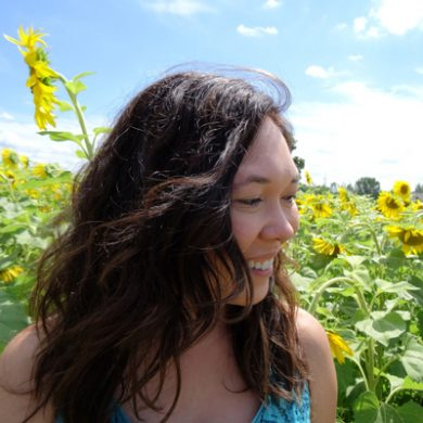 Jady Carmichael with a field of sunflowers in the background