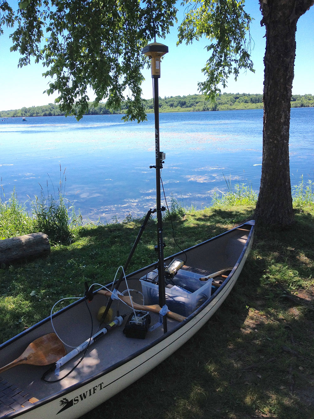 Canoe set up to measure location and elevation, water chemistry, and record video